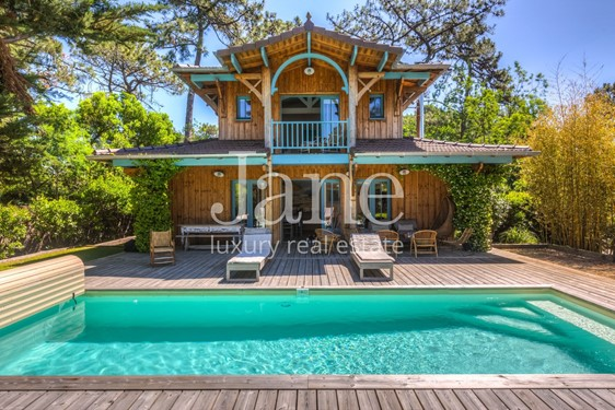 beautiful villa in the spirit of a hut with swimming pool